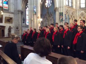 The choir performs at the first concert and are well received by the locals.