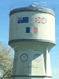 The Bullecourt Water Tower noting the Australian, French and British flags and AIF and British insignia painted in 2007 commemorating 90 years since the battle of Arras.