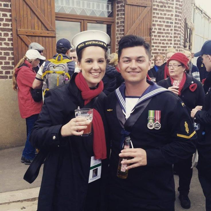 Chorister Isabelle Fassbind making friends with Robbie Sandner from the Royal Australian Navy Band.