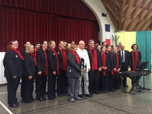Julie Christiansen, Paul Holley and the choir with the Mayor of Villers-Bretonneux.
