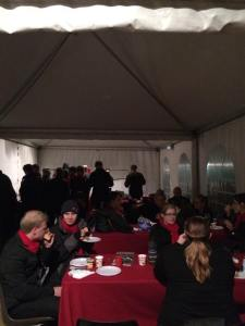 The choir is snug in the tent for brekky.