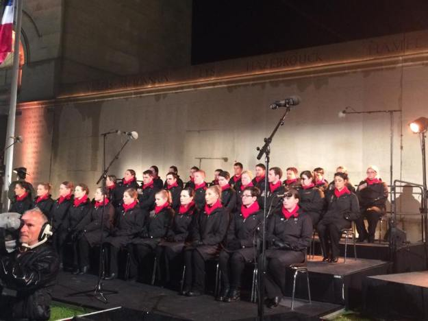 The choir is back out for the dawn service - this time, no ponchos.
