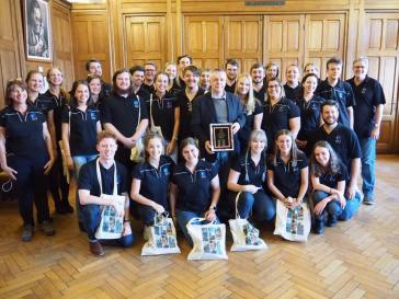 Our choristers with their gift (pic by Brian)