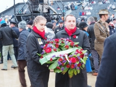 Kate and Josh lay a wreath on behalf of Voices of Birralee (pic by Brian)