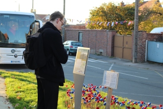 Josh outside the museum with the crotched poppies for all the France and Australian soldiers who died